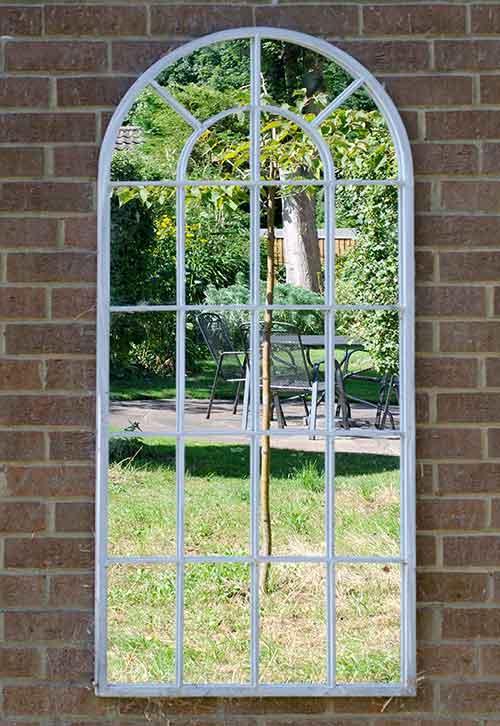 A garden wall mirror