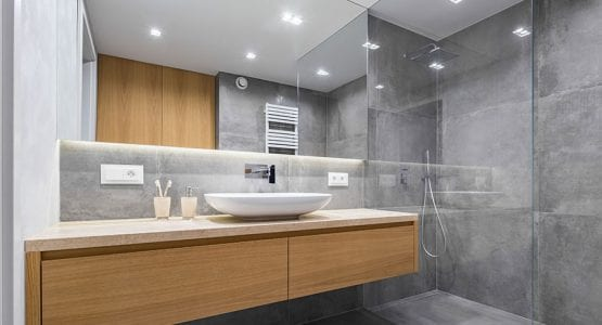 Large bathroom mirror makes this small room appear much larger