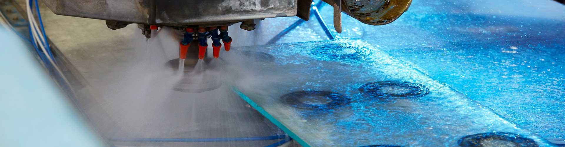 Automated machine polishing glass edges at abc Glass Processing