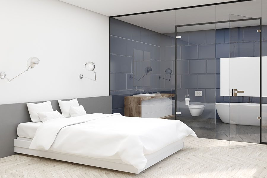 Glass partition wall to ensuite bathroom