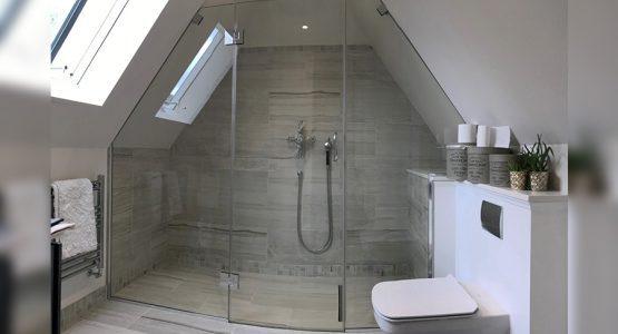bespoke cut shower screen and door under sloped roof