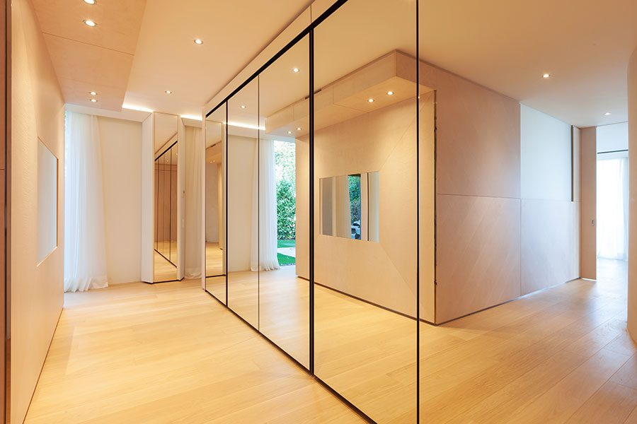 Mirrored walls adding light and feeling of space