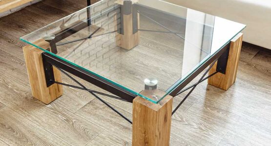 Square glass top table with wooden legs